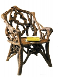 Armchair in roots of forest